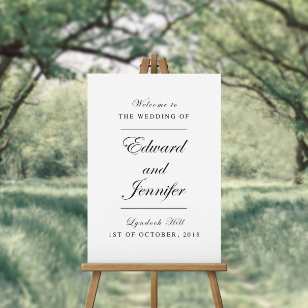 Black and white hand script font wedding welcome sign